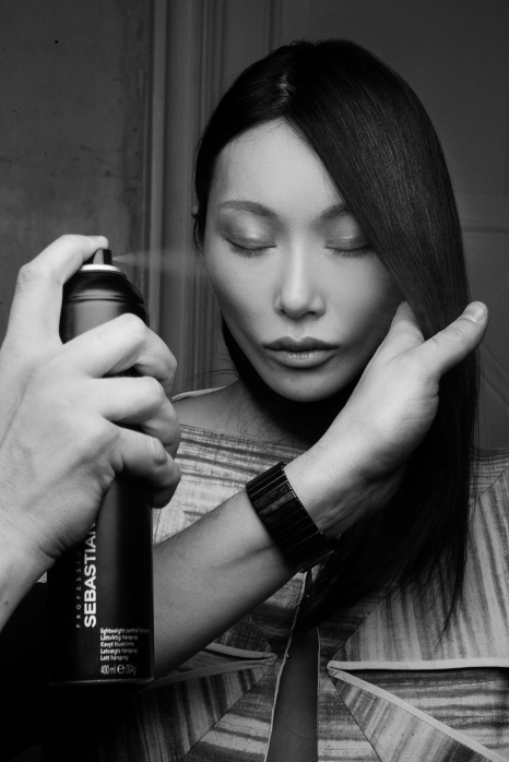 Finishing touches, on a model ready to hit the runway for Yulia Ten.